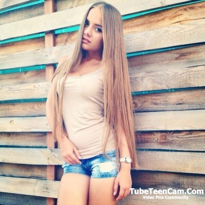 Sexy teen in jeans shorts and long hair
