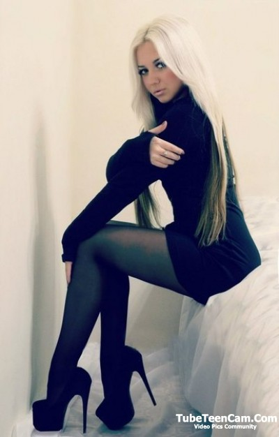 Nasty blonde teen with long hair on high heels