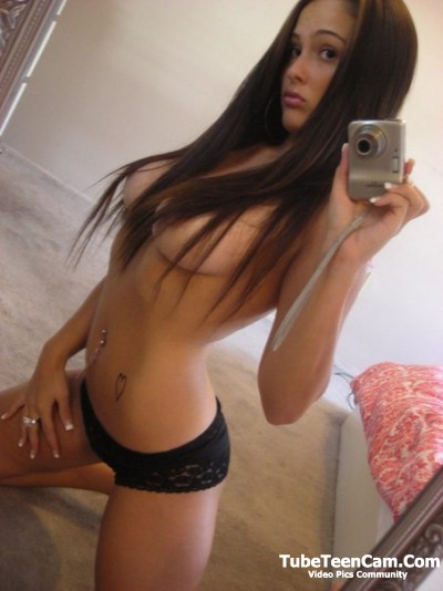 Pretty teen girl with long hair and big sweet tits selfie photo