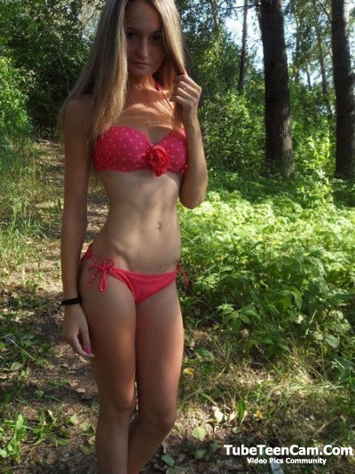 Pretty blonde teen in the wood
