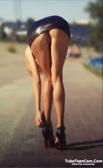 Long legs girl in mini skirt without underwear