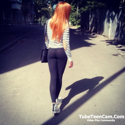 Sexy teen walk on street in leggins