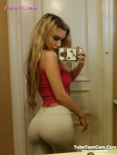 Slim girl with a big booty in grey yoga pants