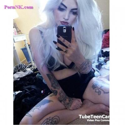 Tattooed women selfie