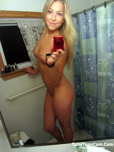 Cute blonde selfie in a bathroom